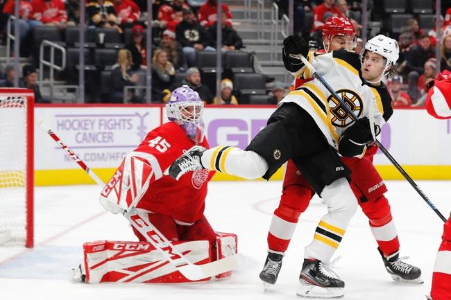 Image result for bruins red wings little caesars arena